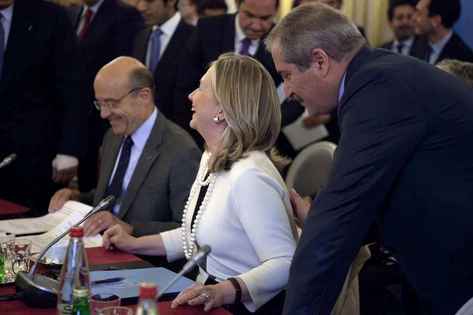 Photo -   From left, France's Foreign Minister Alain Juppe, Secretary of State Hillary Rodham Clinton, and an unidentified participant speak before meeting on Syria, Thursday, April 19, 2012, in Paris. (AP Photo/Jacquelyn Martin, Pool)