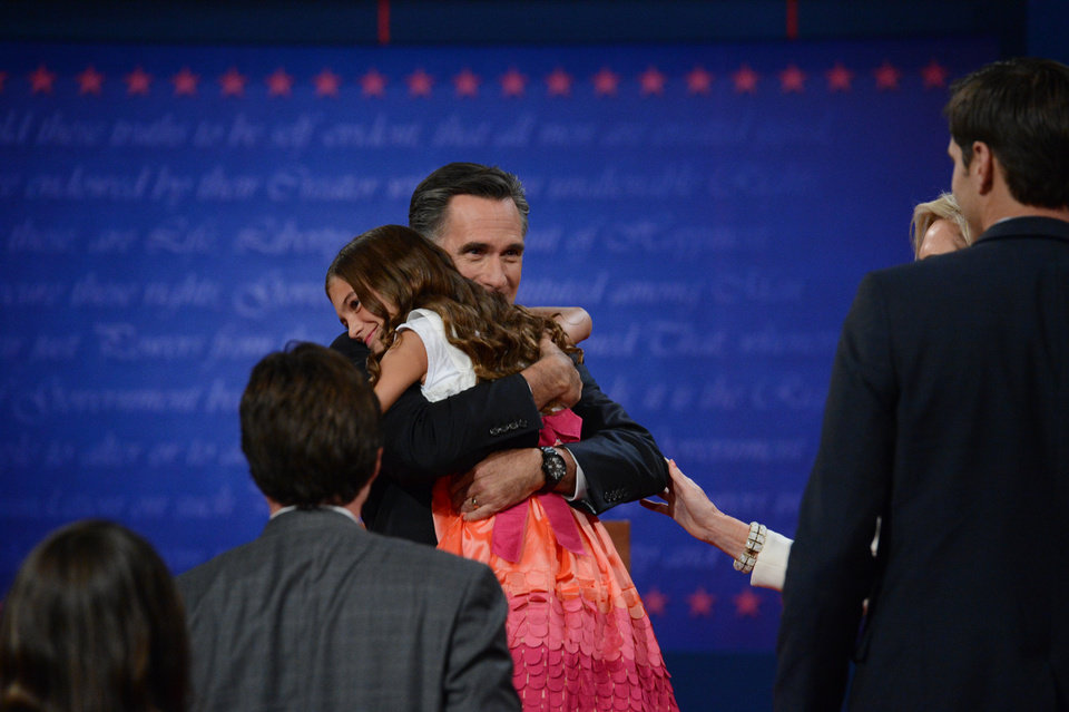 Photo - Former Massachusetts Gov. Mitt Romney gets a hug after the presidential debate at the University of Denver Wednesday, Oct. 3, 2012, in Denver. (AP Photo/The Denver Post, John Leyba) MAGS OUT; TV OUT; INTERNET OUT ORG XMIT: CODEN217