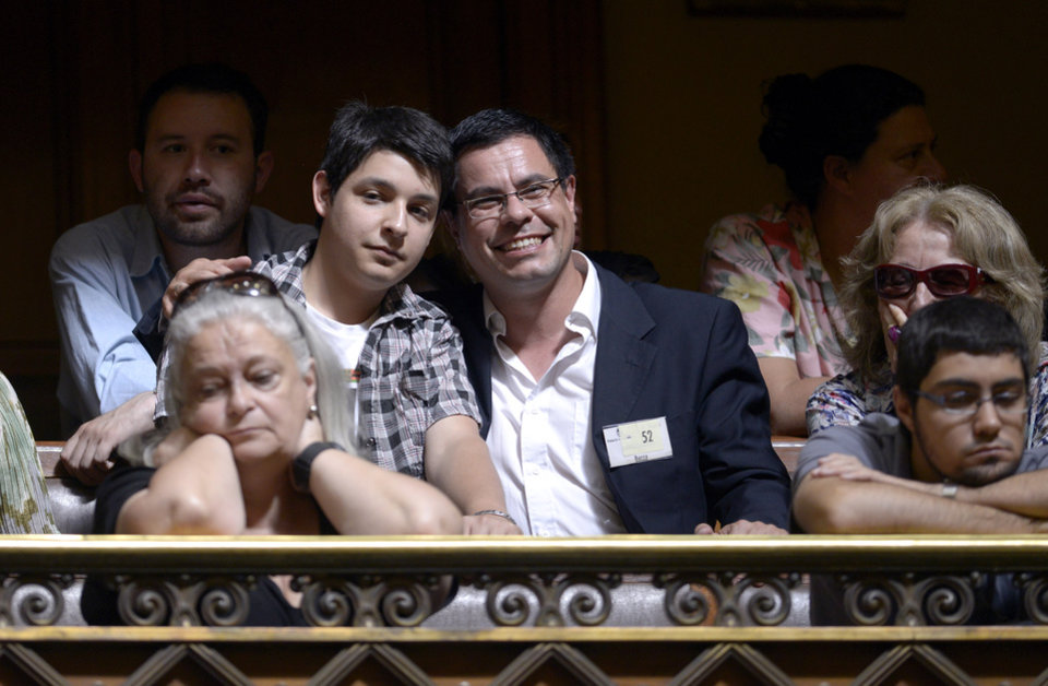 Federico Maserattini, left, and Omar Salsamendi, both from Uruguay who got married last week in Buenos Aires, Argentina, smile toward the camera as they attend the debate of a same sex marriage law at Parliament in Montevideo, Uruguay, Tuesday, Dec. 11, 2012. Taboo-breaking Uruguay is poised to legalize gay marriage, with lawmakers debating Tuesday whether to create a single law governing marriage for heterosexuals and homosexuals.  The new proposal would make Uruguay the second nation in Latin America and the 12th in the world to legalize gay marriage, after The Netherlands, Belgium, Spain, Canada, South Africa, Norway, Sweden, Portugal, Iceland, Argentina and Denmark. (AP Photo/Matilde Campodonico)