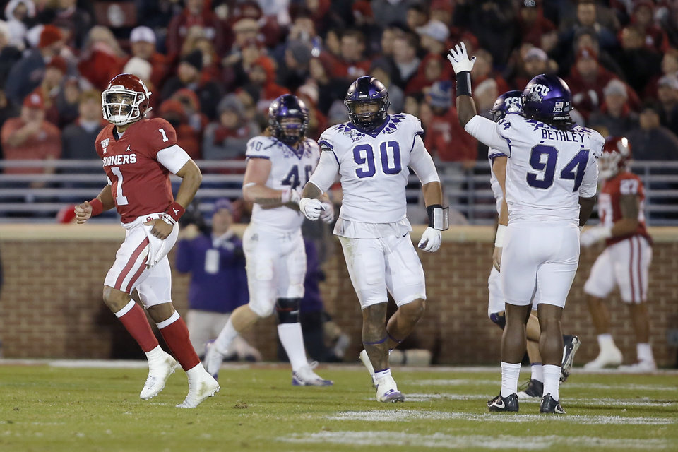 Photo - Oklahoma's Jalen Hurts (1) jogs past TCU as they celebrate after returning an interception for a touchdown during an NCAA football game between the University of Oklahoma Sooners (OU) and the TCU Horned Frogs at Gaylord Family-Oklahoma Memorial Stadium in Norman, Okla., Saturday, Nov. 23, 2019. Oklahoma won 28-24. [Bryan Terry/The Oklahoman]