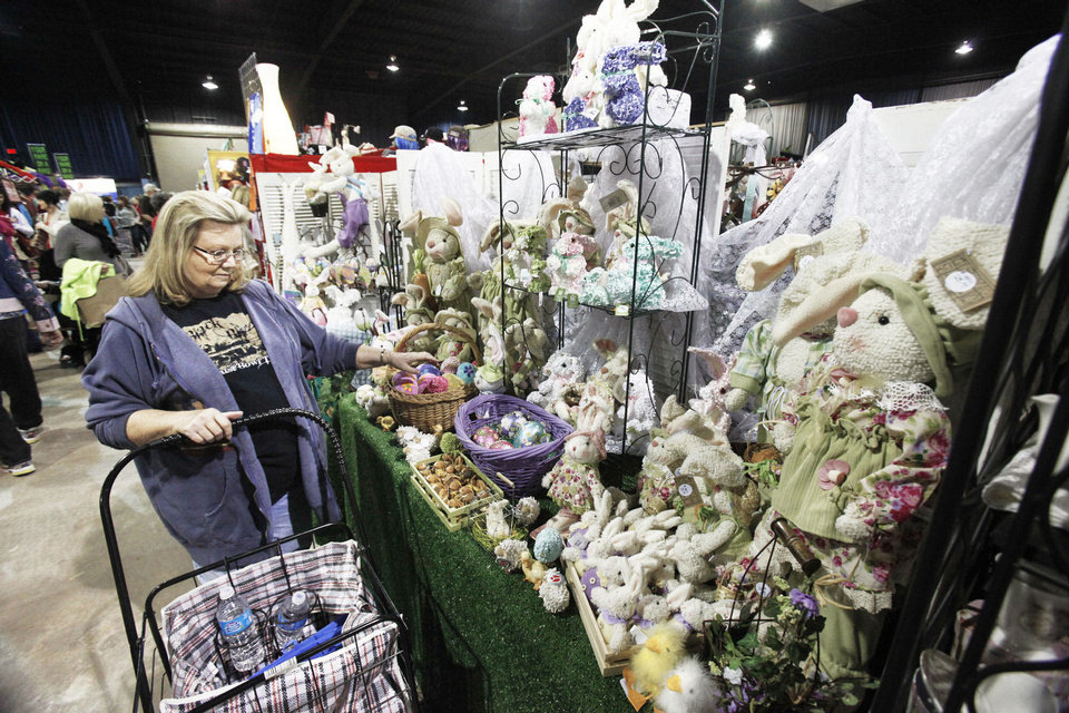 Photo - Carol Dodge looks at stuffed bunnies during the first day of An Affair of the Heart at State Fair Park. PHOTOS BY PAUL HELLSTERN, The Oklahoman