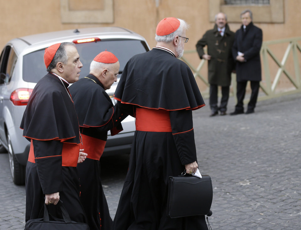 Photo - Cardinal Daniel Nicholas DiNardo, left, and Cardinal Sean Patrick O'Malley, right, arrive for a meeting, at the Vatican, Wednesday, March 6, 2013. Cardinals from around the world have gathered inside the Vatican for a round of meetings before the conclave to elect the next pope, amid scandals inside and out of the Vatican and the continued reverberations of Benedict XVI's decision to retire. (AP Photo/Alessandra Tarantino)