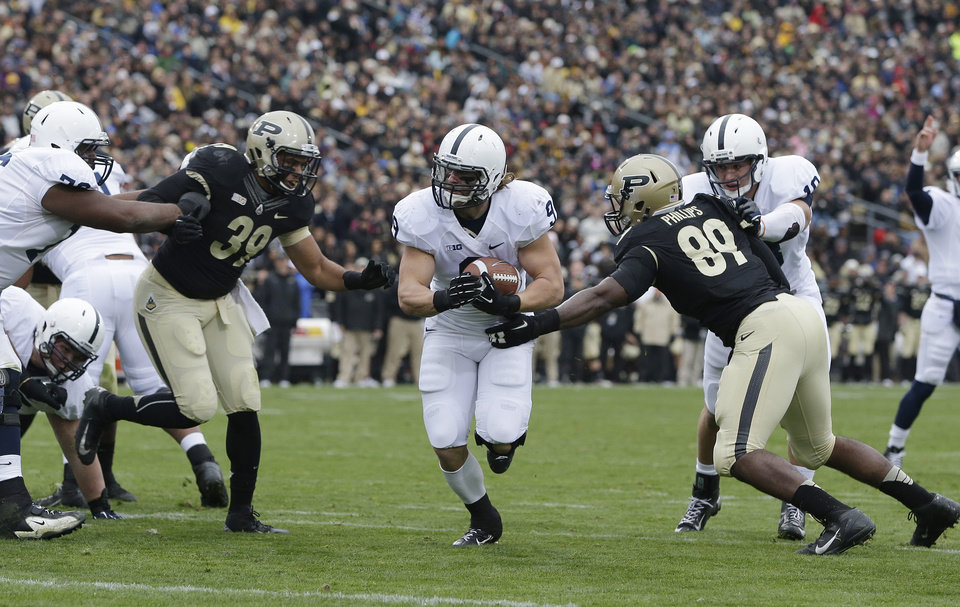 Photo -   Penn State's Michael Zordich goes in for a six yard touchdown run against Purdue's Joe Gilliam (39) and Jalani Phillips (89) during the first half of an NCAA college football game Saturday, Nov. 3, 2012, in West Lafayette, Ind. (AP Photo/Darron Cummings