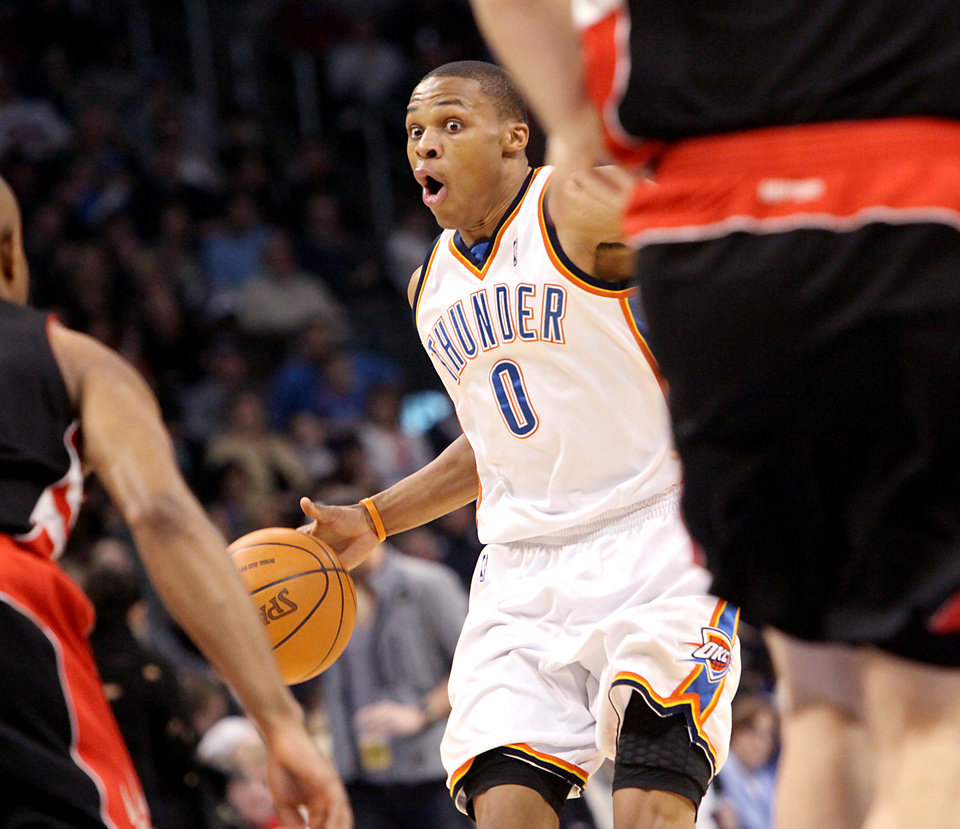 Oklahoma City's Russell Westbrook looks for room between Toronto defenders during their NBA basketball game at the Ford Center in Oklahoma City on Sunday, Feb. 28, 2010. Photo by John Clanton, The Oklahoman