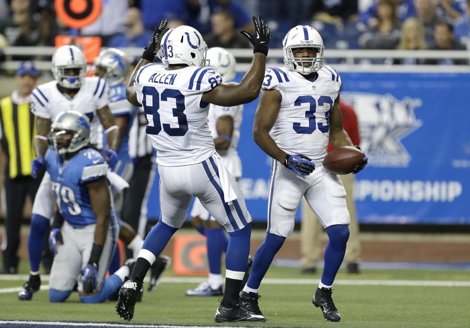 Indianapolis Colts tight end Dwayne Allen (83) rushes in to congratulate running back Vick Ballard (33) on his touchdown during the third quarter of an NFL football game against the Detroit Lions in Detroit, Sunday, Dec. 2, 2012. (AP Photo/Paul Sancya)