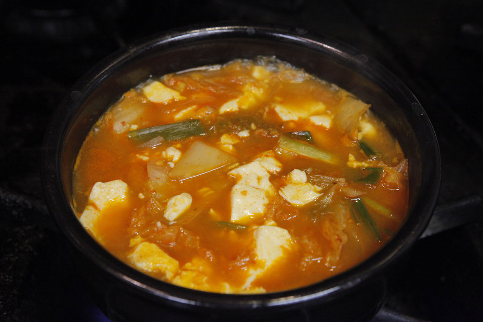 Kimchi Soon Tofu at Jeon Ju is an authentic Korean soup that features  exotic ingredients and an incendiary disposition. <strong>David McDaniel - The Oklahoman</strong>