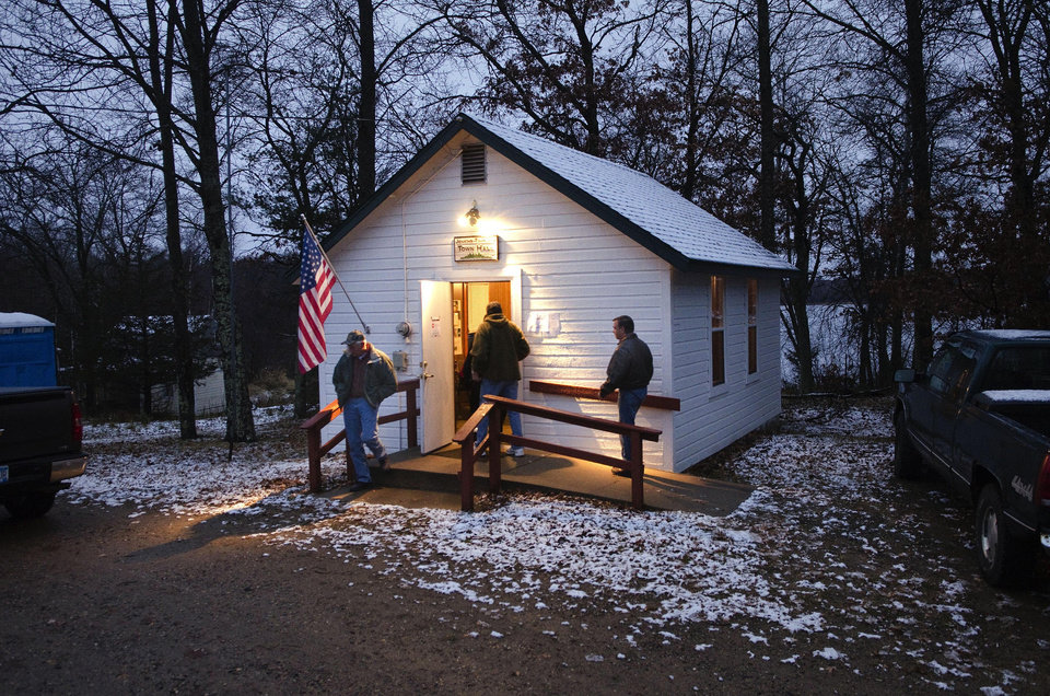 Photo -   A light wet snow covers the roof and ground around the Jenkins Town Hall as early voters casts their ballots Tuesday, Nov. 6, 2012 in Jenkins, Minn. Jenkins is located in Crow Wing County in northern Minnesota. (AP Photo/Tom Olmscheid)