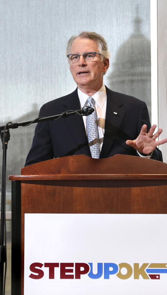 Photo - David Rainbolt, an Oklahoma banker,  unveils reform and revenue measures at a news conference in the atrium of the Oklahoma History Center.  Frustrated by a legislative budget impasse that has stalled state progress, a statewide coalition of Oklahoma business and civic leaders (STEPUPOK) proposed a comprehensive solution Thursday, Jan. 11, 2018,  that would increase state revenues, fund $5,000 teacher pay raises and alter the structure of state and county government.  The proposal calls for raising gross production, motor fuel and cigarette taxes, while eliminating certain individual income tax deductions and loopholes.  The business leaders said their willingness to support the proposed revenue hikes is directly tied to lawmakers' willingness to vote for $5,000 teacher pay increases and embrace 10 reforms to the structure of state and county government, many of which also would require the public's approval through votes on constitutional amendments.  Photo by Jim Beckel, The Oklahoman