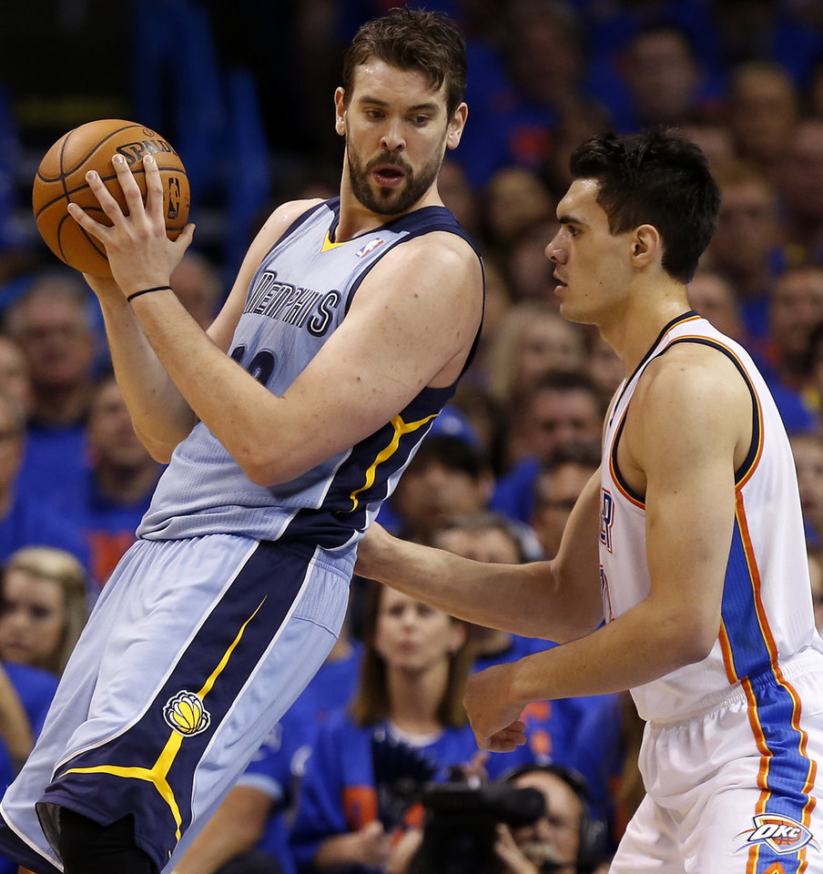 Photo - Oklahoma City's Steven Adams (12) defends Memphis' Marc Gasol (33) during Game 7 in the first round of the NBA playoffs between the Oklahoma City Thunder and the Memphis Grizzlies at Chesapeake Energy Arena in Oklahoma City, Saturday, May 3, 2014. Photo by Nate Billings, The Oklahoman