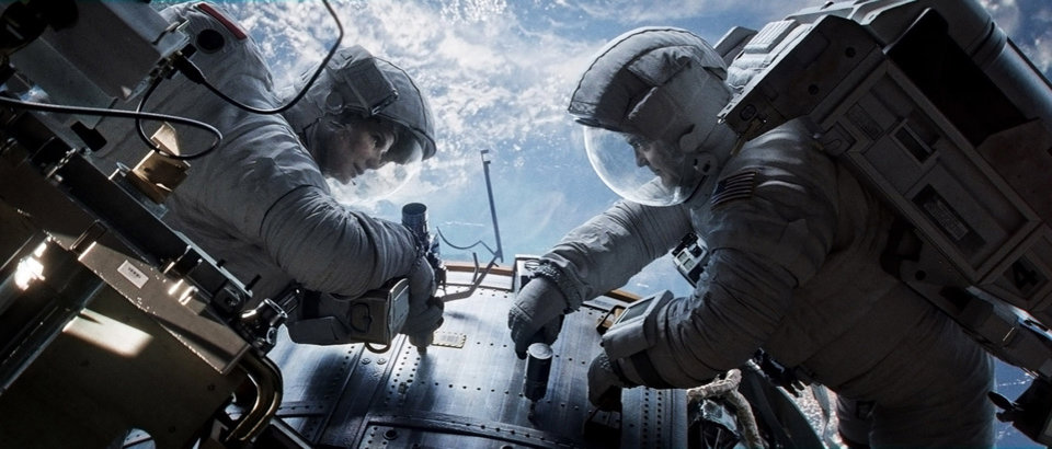 "Photo - This publicity photo released by Warner Bros. Pictures shows Sandra Bullock, left, as Dr. Ryan Stone and George Clooney as Matt Kowalsky in Â""Gravity."" (AP Photo/Courtesy Warner Bros. Pictures)"