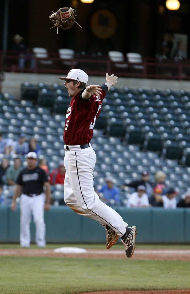 Photo - Tuttle Connor Litterell celebrates the class 4A state baseball championship over Dewey at the Chickasaw Bricktown Ballpark in Oklahoma City, Saturday, May 17, 2014. Photo by Sarah Phipps, The Oklahoman