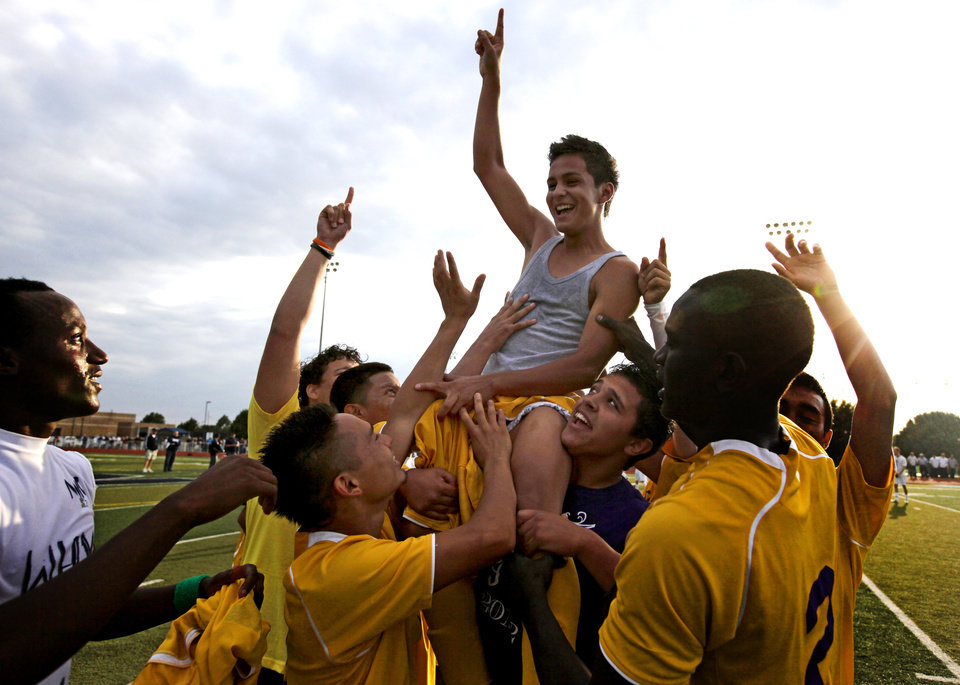 Northwest Classen players lift Juan Campos on their shoulders after he scored the winning goal in sudden death play during the boys 5A soccer state championship game between Northwest Classen and Cascia Hall at Edmond North High School in Edmond, Okla., Saturday, May 12, 2012. Photo by Sarah Phipps, The Oklahoman