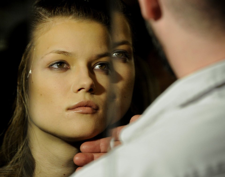 A model is prepared backstage before the showing of the fall 2009 collection of Alexander Wang during Fashion Week, Saturday, Feb. 14, 2009, in New York. (AP Photo/ Louis Lanzano)