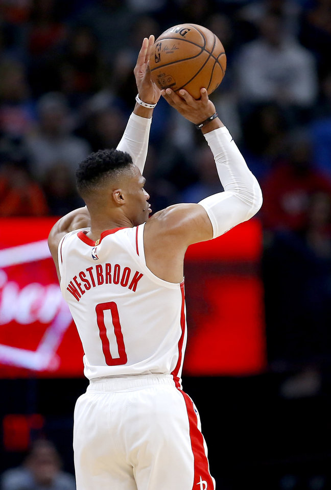 Photo - Houston's Russell Westbrook (0) shoots a 3-point basket during the NBA basketball game between the Oklahoma City Thunder and the Houston Rockets at the Chesapeake Energy Arena in Oklahoma City,  Thursday, Jan. 9, 2020.  [Sarah Phipps/The Oklahoman]
