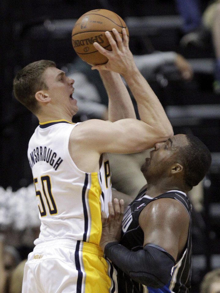 Photo -   Indiana Pacers forward Tyler Hansbrough, left, hits Orlando Magic forward Glen Davis with his elbow as he shoots in the first half of Game 5 of an NBA basketball first-round playoff series, in Indianapolis on Tuesday, May 8, 2012. (AP Photo/Michael Conroy)