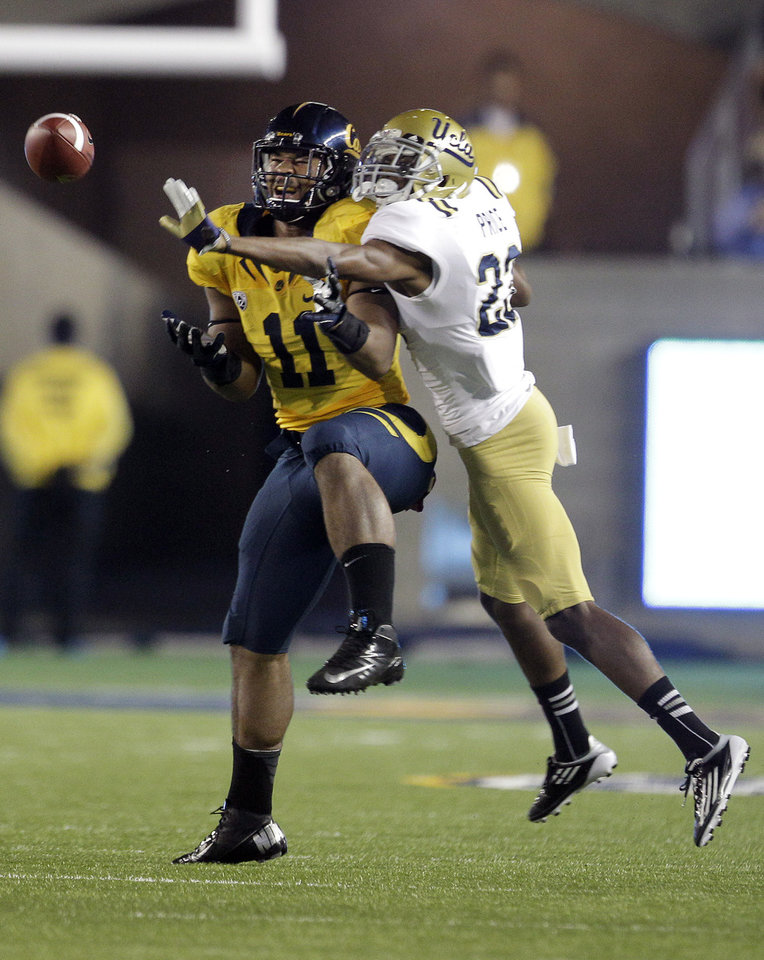 Photo -   California tight end Richard Rodgers (11) makes a catch against UCLA defensive back Kenny Orjioke (23) during the first half of an NCAA college football game in Berkeley, Calif., Saturday, Oct. 6, 2012. (AP Photo/Tony Avelar)