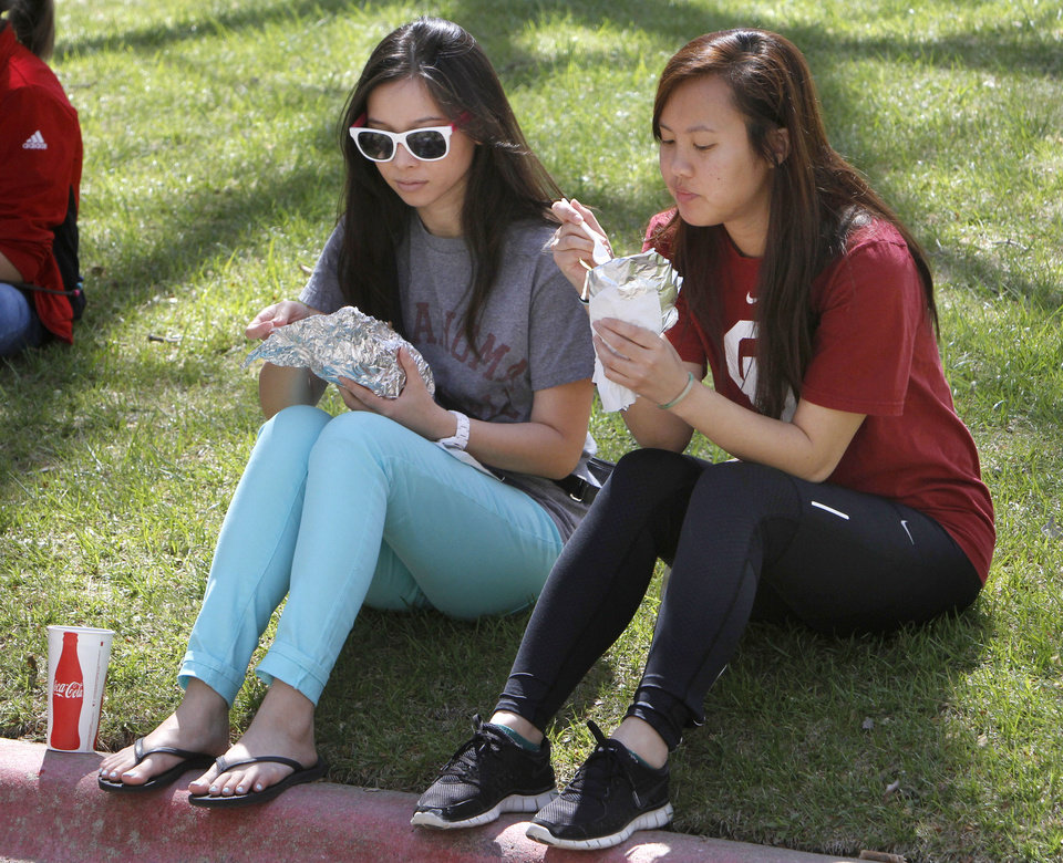 Cindy Le, left, and Tammy Nguyen enjoy Gyros during the Festival of the Arts in downtown Oklahoma City, OK, Thursday, April 25, 2013,  By Paul Hellstern, The Oklahoman