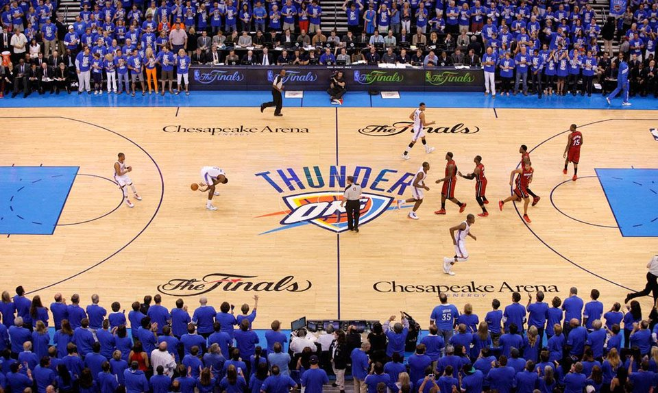 Oklahoma City's Kendrick Perkins (5) passes the ball between his legs to Russell Westbrook (0) after the tip during Game 1 of the NBA Finals between the Oklahoma City Thunder and the Miami Heat at Chesapeake Energy Arena in Oklahoma City, Tuesday, June 12, 2012. Photo by Bryan Terry, The Oklahoman