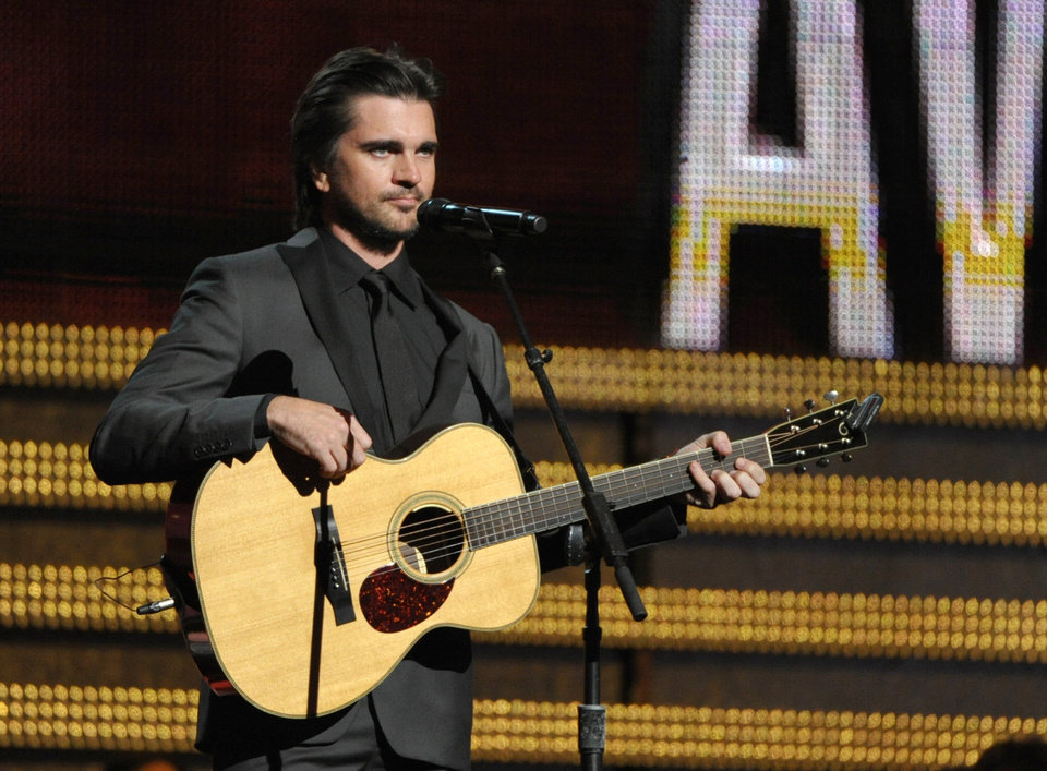 Photo - Juanes performs at the 55th annual Grammy Awards on Sunday, Feb. 10, 2013, in Los Angeles. (Photo by John Shearer/Invision/AP)