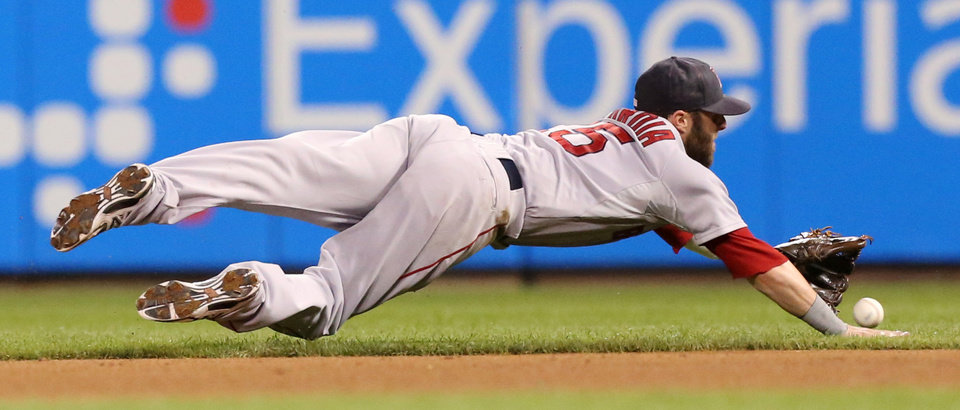 Photo - Boston Red Sox's Dustin Pedroia dives to stop a line drive single by St. Louis Cardinals' Matt Carpenter the the fifth inning of a baseball game Tuesday, Aug. 5, 2014, in St. Louis. (AP Photo/St. Louis Post-Dispatch, Chris Lee)