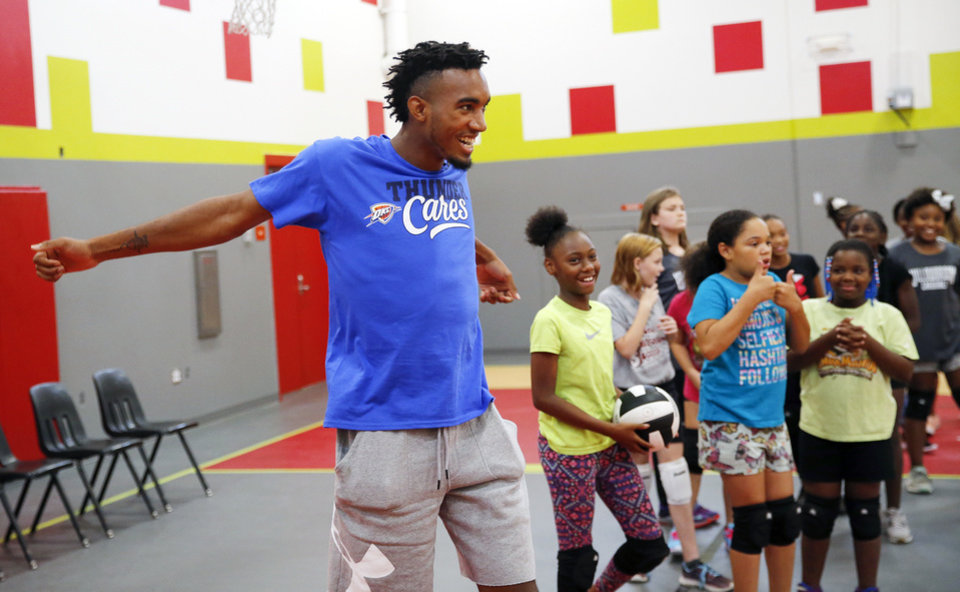 Photo -  Terrance Ferguson clowns around with students two weeks ago during a visit to Willow Brook Elementary School in Midwest City. [PHOTO BY NATE BILLINGS, THE OKLAHOMAN]