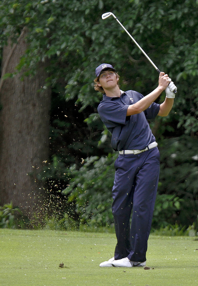 Edmond North's Nick Heinen hits his approach shot on the ninth hole during the 6A golf tournament at Karsten Creek on Tuesday, May 8, 2012, in Stillwater, Oklahoma. Photo by Chris Landsberger, The Oklahoman