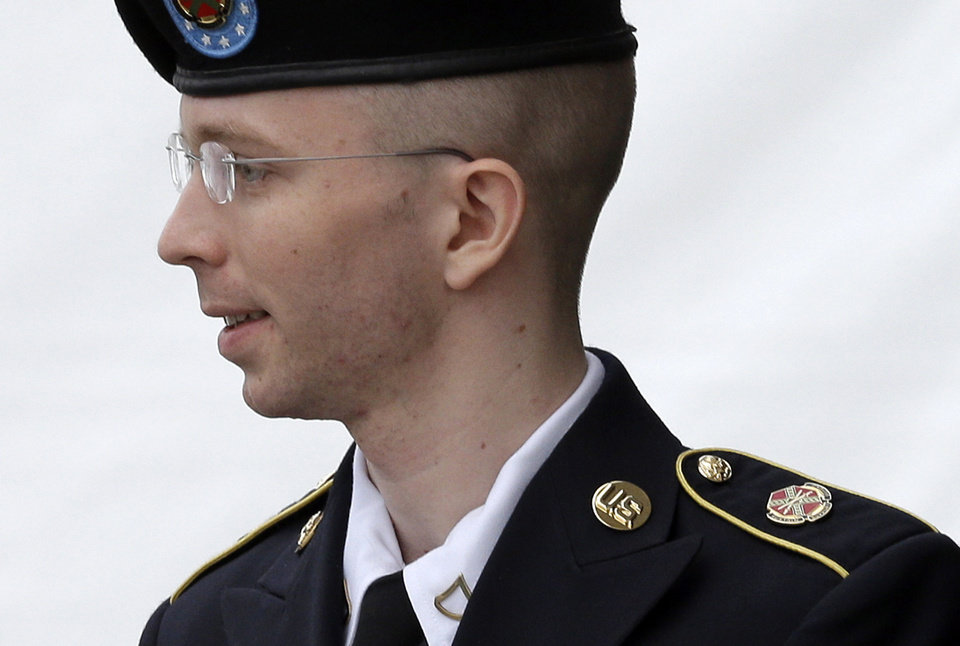 Army Pfc. Bradley Manning is escorted out of a courthouse in Fort Meade, Md., Tuesday, July 30, 2013, after receiving a verdict in his court martial. Manning was acquitted of aiding the enemy � the most serious charge he faced � but was convicted of espionage, theft and other charges, more than three years after he spilled secrets to WikiLeaks. (AP Photo/Patrick Semansky)