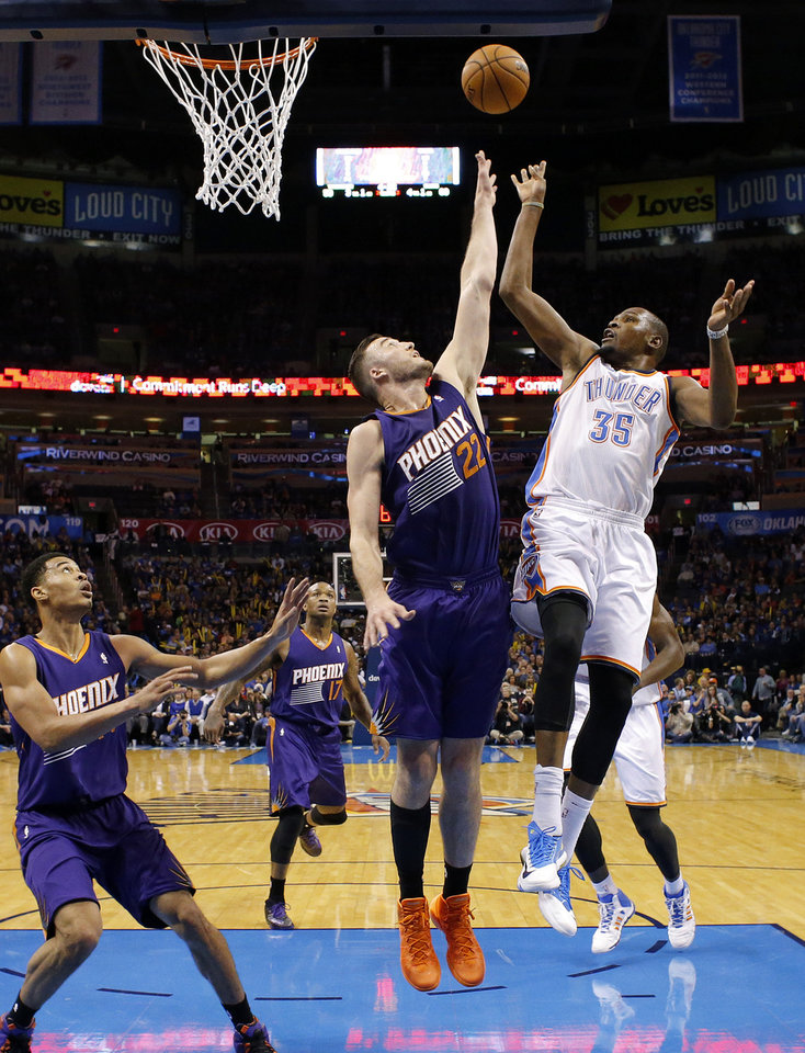 Oklahoma City Thunder small forward Kevin Durant (35) puts up a shot over Phoenix Suns power forward Miles Plumlee (22) during an NBA basketball game between the Oklahoma City Thunder and the Phoenix Suns at Chesapeake Energy Arena in Oklahoma City, Sunday, Nov. 3, 2013. Oklahoma City won 103-96. Photo by Bryan Terry, The Oklahoman