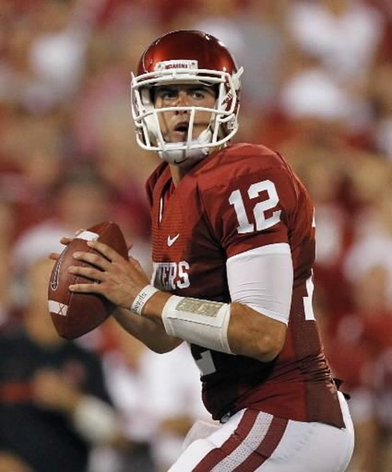 Oklahoma\'s Landry Jones (12) looks to throw the all during the college football game between the University of Oklahoma Sooners ( OU) and the Tulsa University Hurricanes (TU) at the Gaylord Family-Memorial Stadium on Saturday, Sept. 3, 2011, in Norman, Okla. Photo by Chris Landsberger, The Oklahoman ORG XMIT: KOD