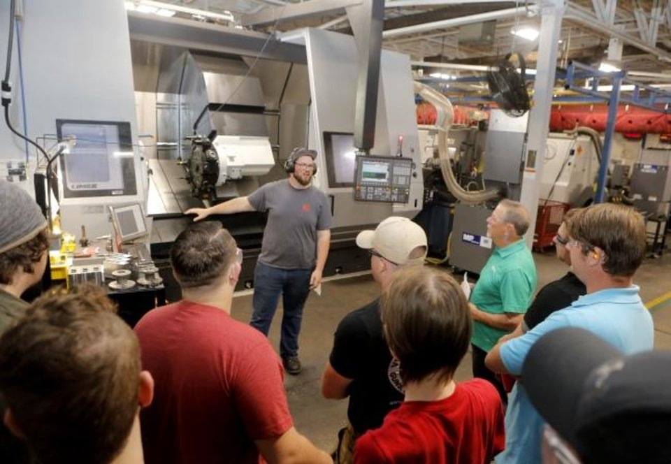 Photo -  Kimray's Timothy Cunkle talks to Francis Tuttle Technology students in Kimray's Machine Shop on Oct. 3, during Manufacturing Day. Kimray makes pressure control valves, controls, regulators, pumps and other components, mostly for the oil and gas business. [PROVIDED]