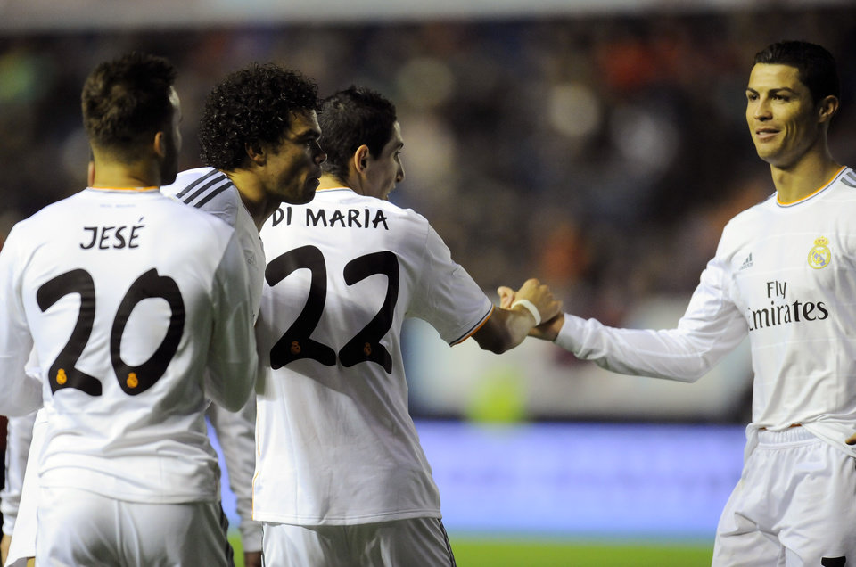 Photo - Real Madrid's Angel Di Maria of Argentina, second right, shakes hand with his teammate Cristiano Ronaldo of Portugal, right, as he celebrates his goal  during their Spanish Copa del Rey round-16 second leg soccer match between Osasuna and Real Madrid , at El Sadar stadium, in Pamplona northern Spain on Wednesday, Jan. 15, 2014. (AP Photo/Alvaro Barrientos)