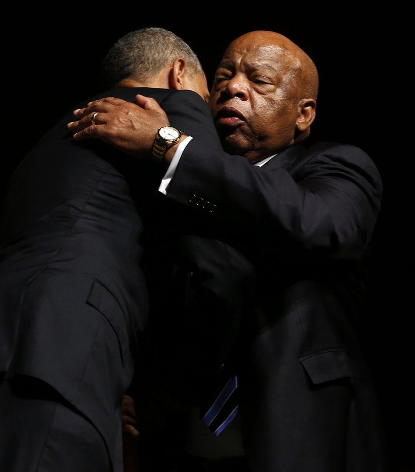 Photo - US Representative John Lewis hugs President Barack Obama after Obama's speech during the Civil Rights Summit at the LBJ Presidential Library in Austin, TX on Wednesday, April 10, 2014. President Barack Obama, celebrating a half-century of the Civil Rights Act, used the image of Lyndon B. Johnson to urge perseverance and courage to move civil rights forward. The nation's first black president spoke at the Civil Rights Summit, examining the 50th anniversary of Johnson's signing the seminal act ending segregation. (AP Photo/The Dallas Morning News, Vernon Bryant)