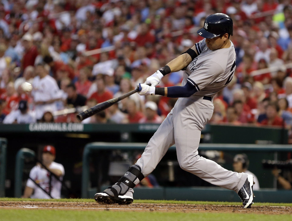 Photo - New York Yankees' Jacoby Ellsbury hits an RBI single during the third inning of a baseball game against the St. Louis Cardinals on Wednesday, May 28, 2014, in St. Louis. (AP Photo/Jeff Roberson)