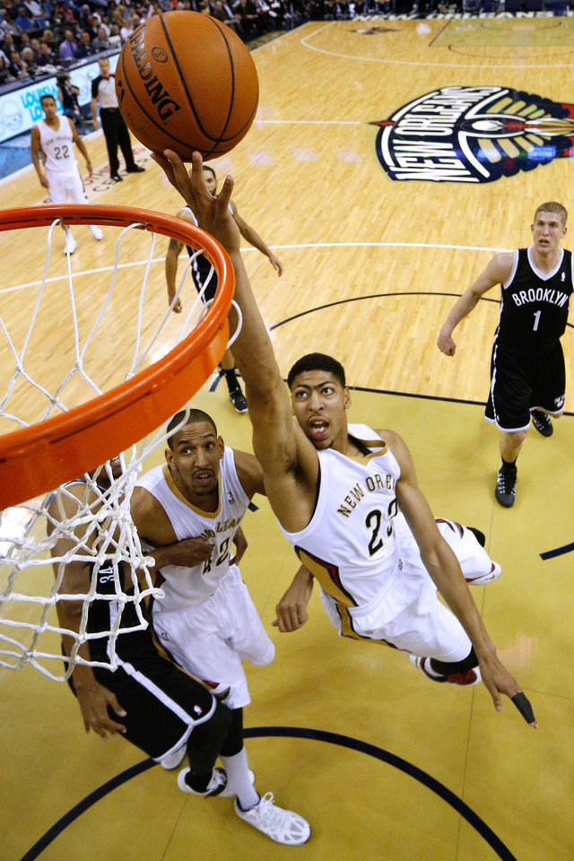 Photo - New Orleans Pelicans forward Anthony Davis (23) shoots the ball during the first half of an NBA basketball game against the Brooklyn Nets in New Orleans, Monday, March 24, 2014. (AP Photo/Jonathan Bachman)