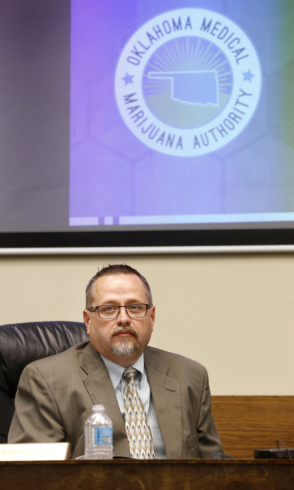 Photo - Timothy Starkey, board president. The Oklahoma State Department of Health voted at their monthly meeting Tuesday morning, July 10, 2018, to ban sales of smokeable forms of medical marijuana and to require dispensaries to hire a pharmacist. The Board of Health voted on 75 pages of rules creating a rough framework for patients, physicians, caretakers and business owners interested in medical marijuana. The ban on sales of leaves and flowers for smoking and the requirement to hire a pharmacist weren't in the draft rules presented to the board, but were a priority of a coalition of medical groups. Julie Ezell, the Health Department's general counsel, presented the rules to a packed board room and to members of the public watching in an overflow room and online. She cautioned board members that the two new rules they added might not be allowed under the state question, inviting a court challenge. Photo by Jim Beckel, The Oklahoman