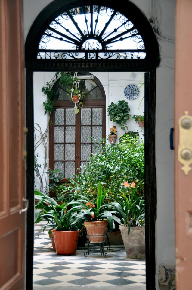 Photo - Cordobans are proud of their pretty patios — peek in to any wide open doors you see. (Photo by Cameron Hewitt)