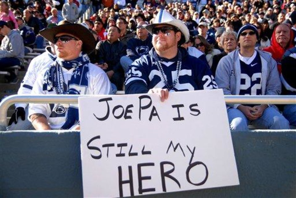 Photo - A Penn State fan displays a sign supporting former Penn State head coach Joe Paterno during the TicketCity Bowl NCAA football game against Houston, Monday, Jan. 2, 2012 at the Cotton Bowl in Dallas. Paterno was fired earlier in the season in the midst of a child sexual abuse scandal. Houston won 30-14. (AP Photo/Jeff McWhorter)