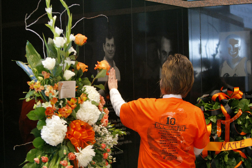 Karlene Durfey touches the memorial of her brother, Kendall Carlton Durfey, before the basketball game between Oklahoma State and Texas, Wednesday, Jan. 26, 2011, at Gallagher-Iba Arena in Stillwater, Okla. Photo by Sarah Phipps, The Oklahoman