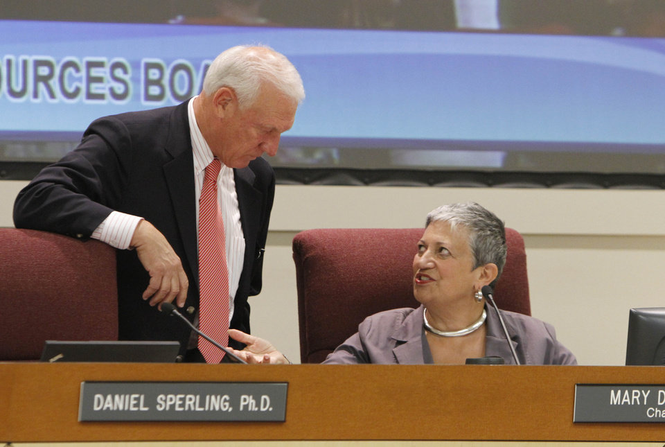 Photo -   California Air Resources Board Member Ron Roberts talks with ARB chair Mary Nichols during a hearing held Thursday, Sept. 20, 2012, in Sacramento, Calif. The board took testimony from experts and the public on the the cost to businesses and consumers with the implementation of AB32, California's landmark greenhouse gas emissions law. (AP Photo/Rich Pedroncelli)