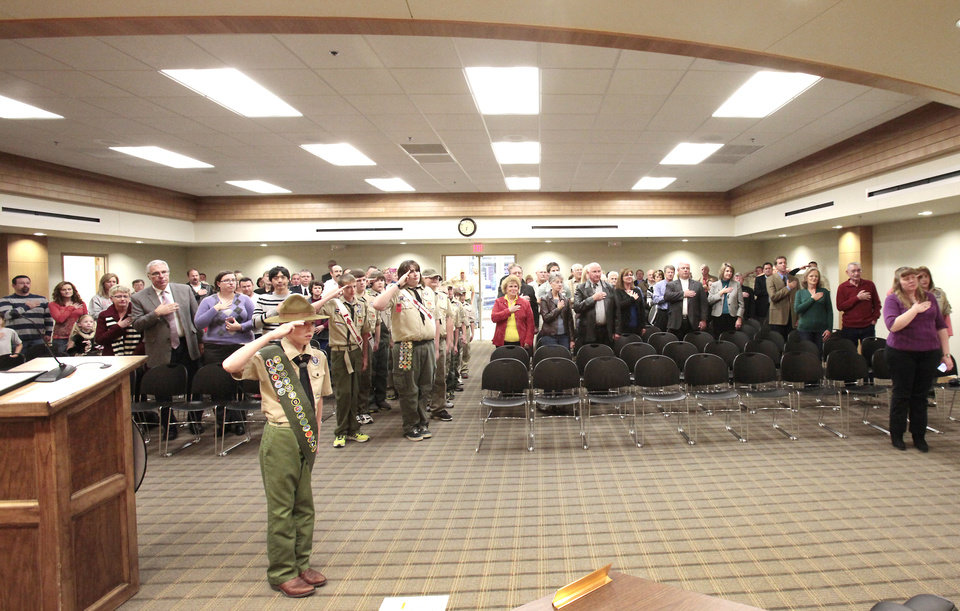First Class Scout Falcon McDulett, Troop 4338, leads the pledge of allegiance at the dedication ceremony for Tuttle's new storm shelter.