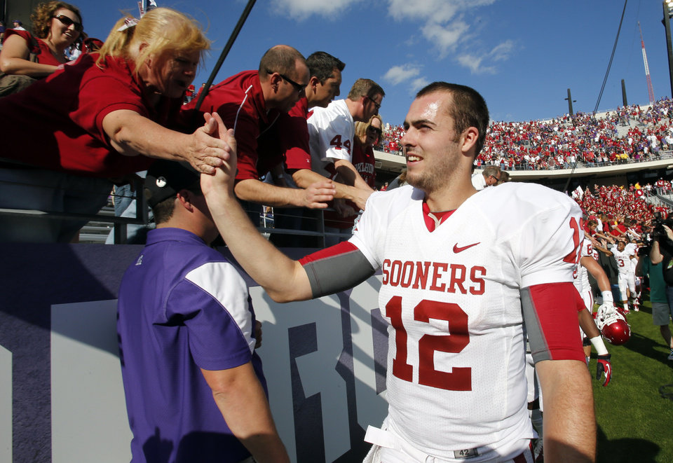 Photo - Quarterback Landry Jones greets fans after the college football game where the University of Oklahoma Sooners (OU) defeated the Texas Christian University Horned Frogs (TCU) 24-17 at Amon G. Carter Stadium in Fort Worth, Texas, on Saturday, Dec. 1, 2012. Photo by Steve Sisney, The Oklahoman