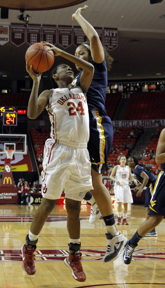 Oklahoma Sooner's Sharane Campbell (24) shoots guarded by West Virginia Mountaineers' Ayana Dunning (33) as the University of Oklahoma Sooners (OU) play the West Virginia Mountaineers in NCAA, women's college basketball at The Lloyd Noble Center on Wednesday, Jan. 2, 2013  in Norman, Okla. Photo by Steve Sisney, The Oklahoman