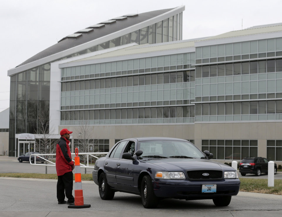 Photo - A police car leaves the training facility for the Kansas City Chiefs NFL football team on Saturday, Dec. 1, 2012, in Kansas City, Mo. A 25-year-old Chiefs player fatally shot his girlfriend early Saturday, then drove to Arrowhead Stadium and committed suicide in front of two team officials, police said. (AP Photo/Charlie Riedel)