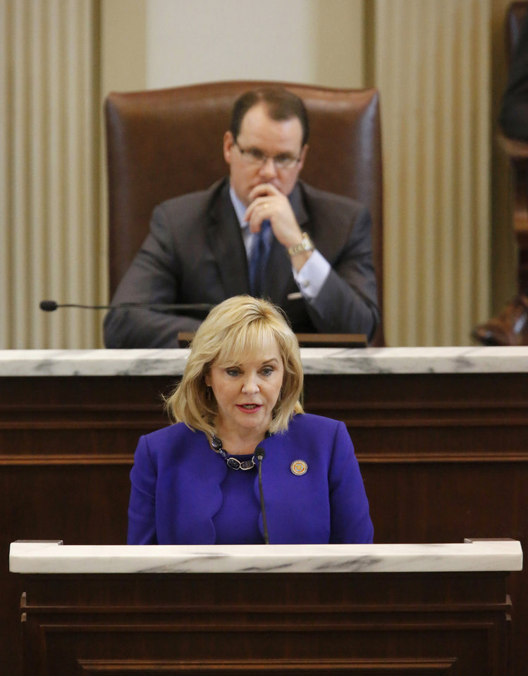 Photo - Gov. Mary Fallin offers goals for the Legislature in her State of the State speech on Monday. Behind her is Lt. Gov. Todd Lamb. Photo by Jim Beckel, The Oklahoman