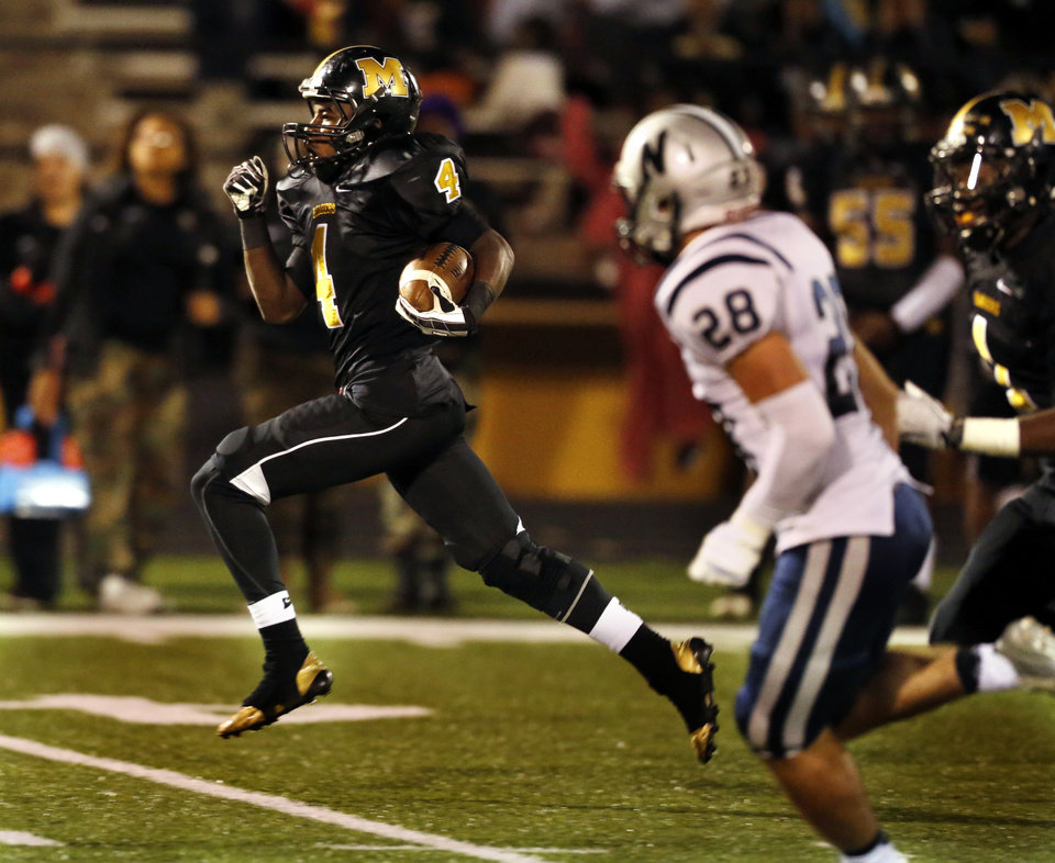 Photo - Midwest City's KeSean Brown heads for the end zone on a long touchdown run during Friday's 19-13 victory over Edmond North in Midwest City. Brown has transitioned from wide receiver to running back for the Bombers.Photo by Steve Sisney, The Oklahoman