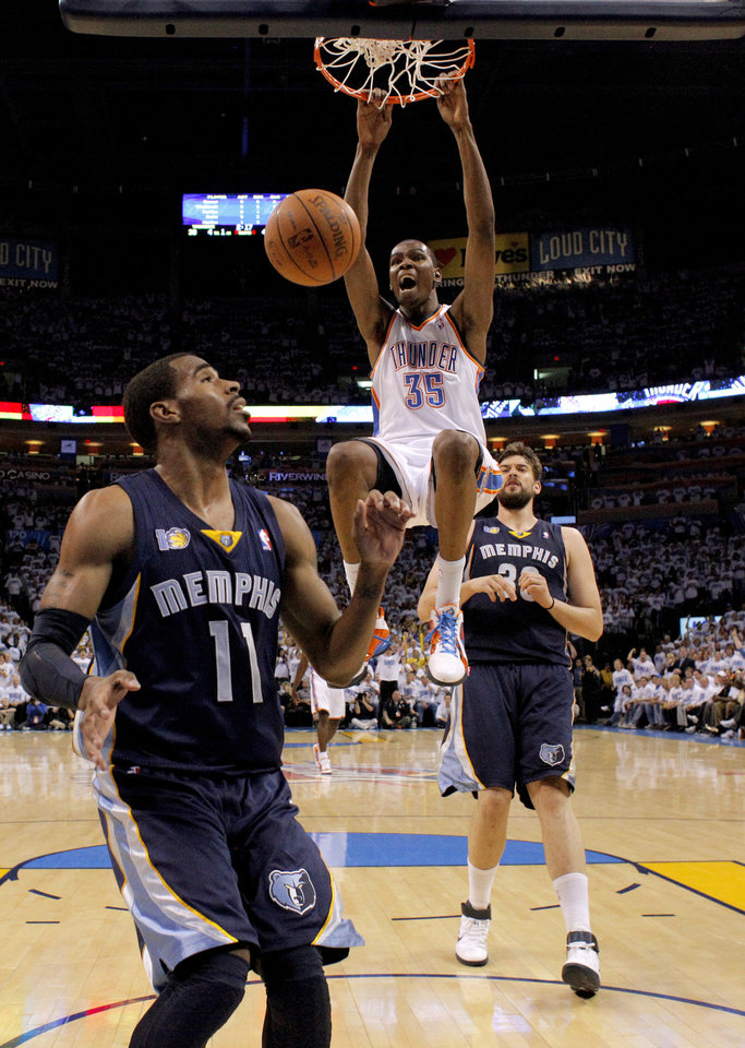 Photo - Oklahoma City's Kevin Durant (35) dunks the ball between Mike Conley (11) and Marc Gasol (33) of Memphis during game five of the Western Conference semifinals between the Memphis Grizzlies and the Oklahoma City Thunder in the NBA basketball playoffs at Oklahoma City Arena in Oklahoma City, Wednesday, May 11, 2011. Photo by Bryan Terry, The Oklahoman