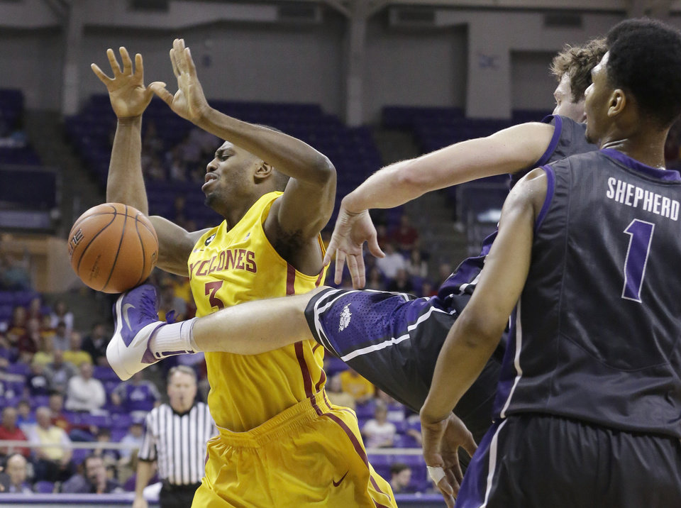 Photo - Iowa State forward Melvin Ejim (3) loses control of the ball against a kick from TCU guard Hudson Price as teammate Karviar Shepherd (1) looks on during the first half of an NCAA college basketball game Saturday, Feb. 22, 2014, in Fort Worth, Texas. (AP Photo/LM Otero)