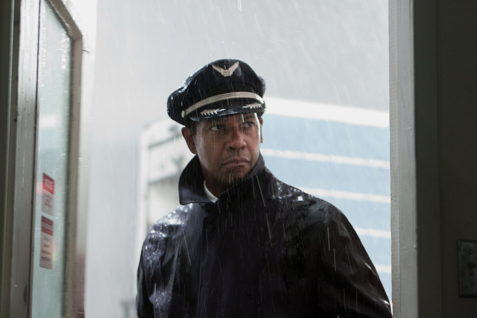 "FILE - This publicity film image released by Paramount Pictures shows Denzel Washington portraying Whip Whitaker in a scene from ""Flight."" Washington plays an airline pilot who, despite being hung-over, drunk and coked-up, manages to bring down a rapidly deteriorating plane in a daring emergency landing on what should have been a routine flight between Orlando, Fla., and Atlanta. Alcohol plays a prominent role in �Flight,� but Anheuser-Busch says it wasn�t consulted beforehand and is asking the filmmakers and Paramount Pictures to remove the Budweiser logo and any other trademarks from the film.(AP Photo/Paramount Pictures, Robert Zuckerman)"