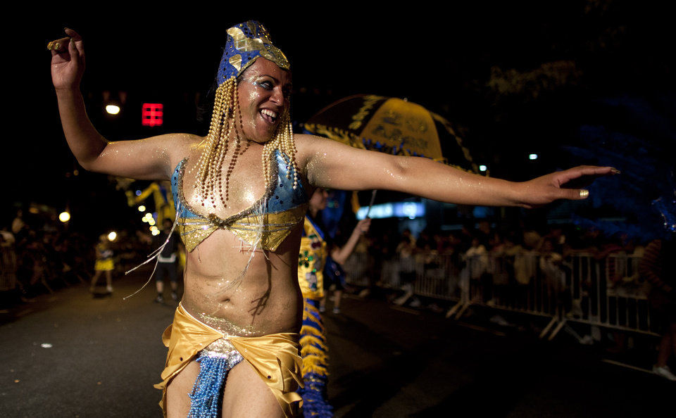 "A member of the murga ""Los amantes de La Boca"" performs during carnival celebrations in Buenos Aires, Argentina, Saturday, Feb. 2, 2013. Argentina�s carnival celebrations may not be as well-known as the ones in neighboring Uruguay and Brazil, but residents of the nation�s capital are equally passionate about their �murgas,� or traditional musical troupes. The murga ""Los amantes de La Boca,� or �The Lovers of The Boca� is among the largest, with about 400 members. It�s a reference to the hometown Boca Juniors, among the most popular soccer teams in Argentina and the world. (AP Photo/Natacha Pisarenko)"