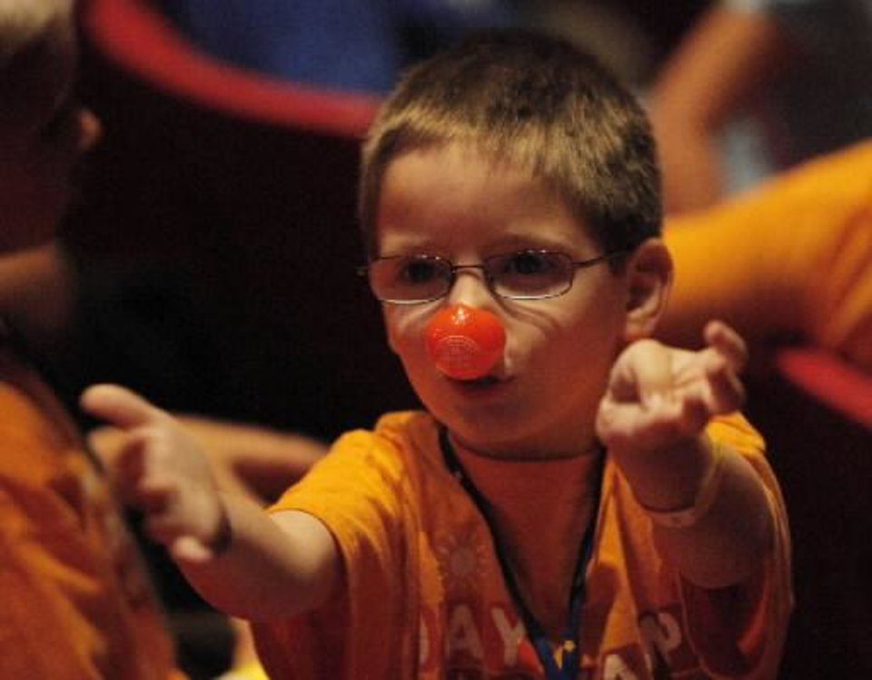 Photo -  Zander Jacobs, 5, of Edmond, wears his clown nose before a Science Live show at the Science Museum of Oklahoma, Wednesday, June 27, 2012. Ringling Bros. clowns showed viewers the science behind circus performance. Photo by Garett Fisbeck, The Oklahoman